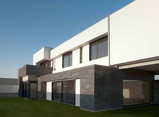 A modern #façade coated with st29  #naturalstone. #wallcoating #outdoors