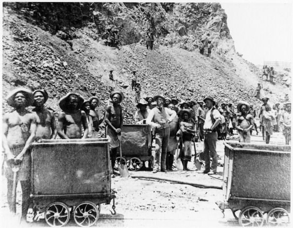 Zulu workers at De Beers diamond mines, Kimberley, South Africa, c1885. In 1887 and 1888 Cecil Rhodes amalgamated the diamond mines around Kimberley, which included De Beers, into Consolidated Mines.