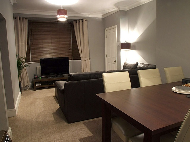 Grey walls with brown leather furniture living room then add