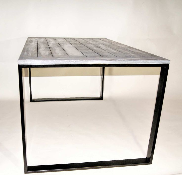 Minimalist table with a light but stable steel construction finished with an oak wood tabletop.  Table can be custom ordered in any size or colour.