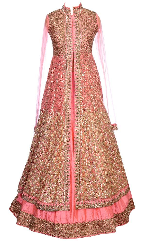 Coral Peach Lacha Set This set features a high collared coral yoke in silk base with an attached coral long jacket. The jacket features a very beautiful all over gold dabka, sequins, zari and coral thread hand embroidery both on the front and back. It is teamed up with a flared coral lehenga in silk base with gold dabka, sequins and zari hand embellished border. It comes with a matching net dupatta with gold sequins and thread hand embroidered border and gold sequins sprinkled on the…