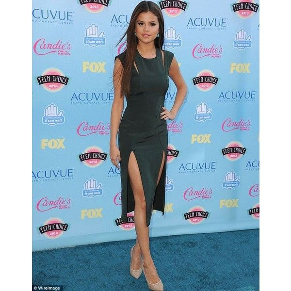 Sexy Selena! Gomez steals the Teen Choice Awards red carpet in a tight... ❤ liked on Polyvore featuring dresses