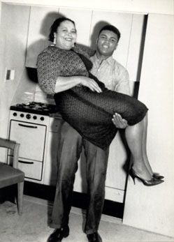 In this 1963 photo by Charles 'Teenie' Harris, Cassius Clay lifts his mother, Odessa Grady Clay, in his hotel room.
