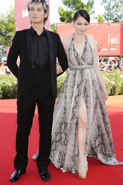 Actor Ando Masanobu and actress Vivian Hsu arrive for the premiere of the film 'Seediq Bale-Warriors of the Rainbow' at the 68th edition of the Venice Film Festival in Venice.