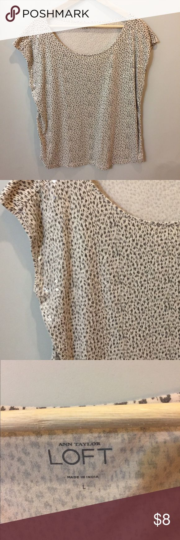 Cap sleeve sequined animal print tee This lady shines! All over front clear/white sequins layered on the animal print cotton base. Eye catching but subtly. Back is not sequined. Because that would be too much. LOFT Tops Tees - Short Sleeve