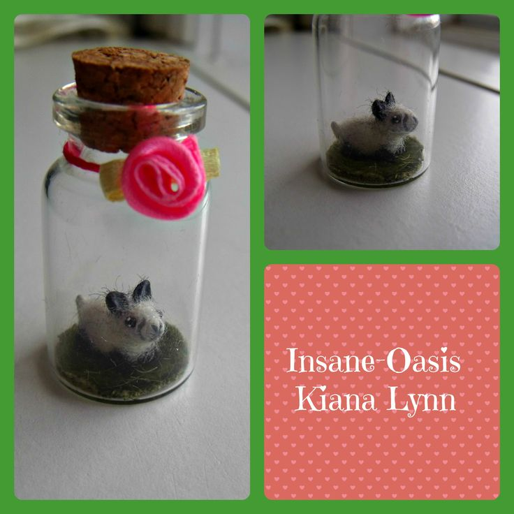 Tiny bunny in a jar. The bunny fits easily on a Canadian penny, and is made of polymer clay which was then covered in yarn fibers.