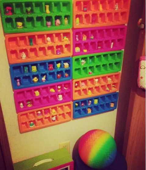 Mount dollar-store ice cube trays to the wall to display Shopkins or other small toys in style.