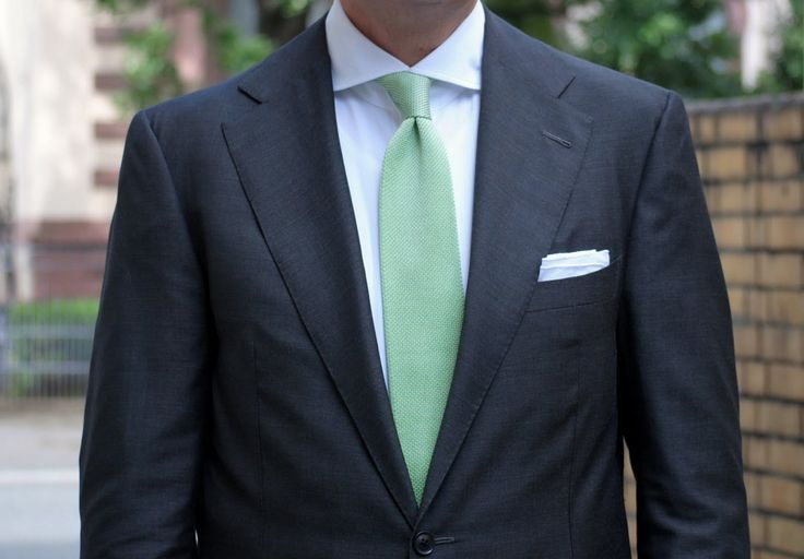 black or deep grey for the rest of the wedding party- groom in light grey. of course- mint tie.