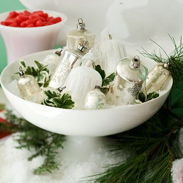 Christmas Snowscape - Spray the outside of a mason jar with adhesive, roll it in Epsom Salts, and put a candle inside it. (The salt will stay contained in the display bowl for no-mess decorating!)