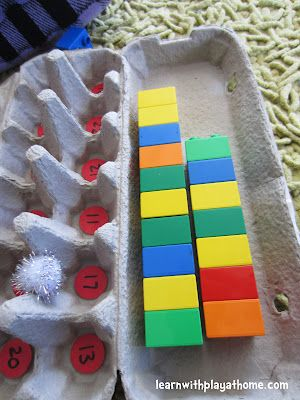 Teen Numbers: Egg carton with teen numbers. Shake a pompom in the closed carton. Build whatever number the pompom lands on with unifix cubes.@ Learn with Play at Home