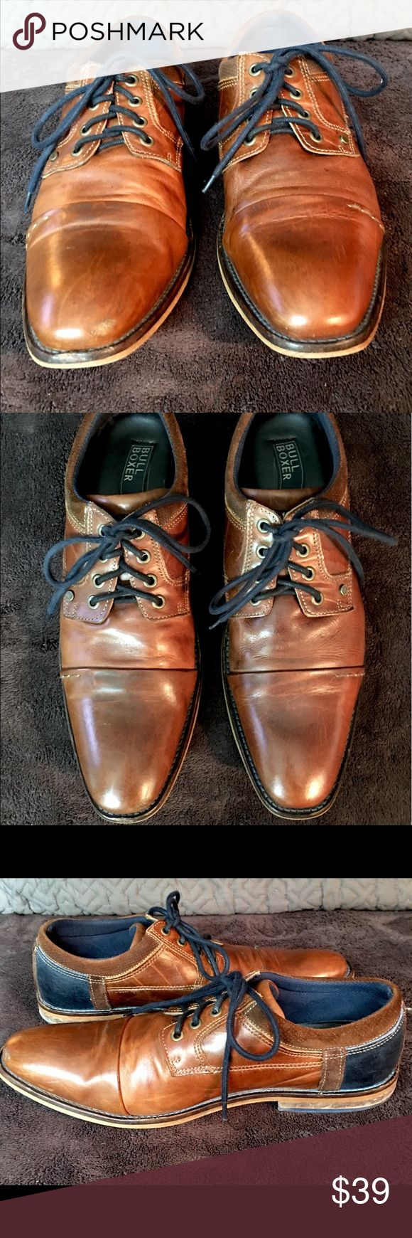 BULL BOXER EUROPEAN LACE UP SHOES EUC BULL BOXER LACE UP DERBYS IN RICH, PATINA BROWN LEATHER W/ STRIKING NAVY LEATHER ACCENTS. SIZE IS MENS 10. Crafted in Portugal, these fine lace ups are the epitome of refinement with a fashion forward twist. The unexpected Navy accents on the heel add just the right amount of whimsy to an otherwise proper shoe. Take a chance, you'll be glad you did! Bull Boxer Shoes Oxfords & Derbys
