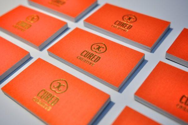 Gold #foilstamp logo on thick, textured, bright orange #businesscards!