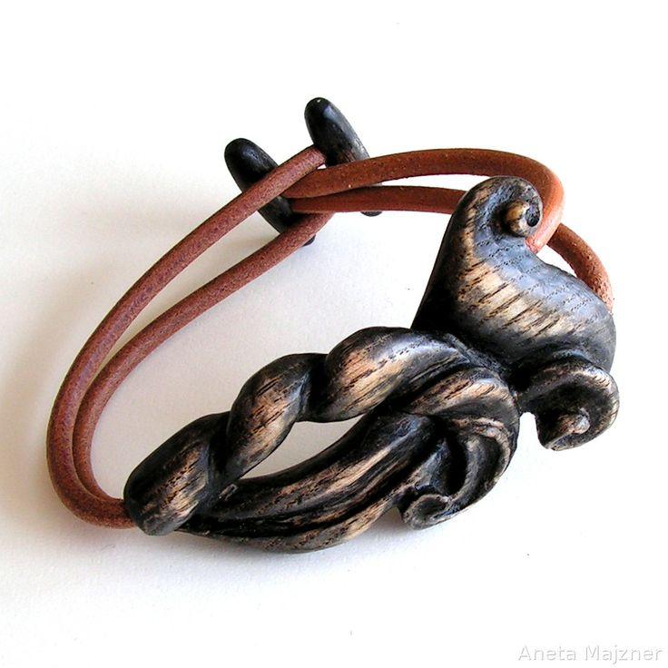 Hand carved wooden jewelry:  https://www.majzner.eu/en/bracelets/1417-bracelet-214.html