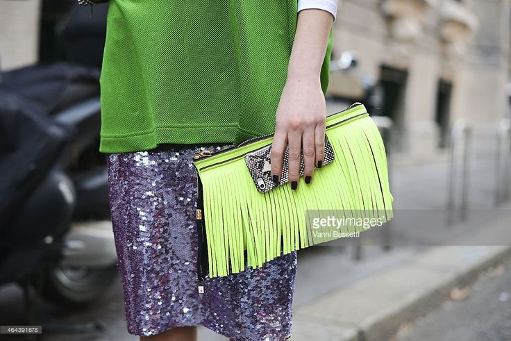 Silvia Torassa poses wearing Parosh top and skirt and Save My Bag bag on February 25, 2015 in Milan, Italy.