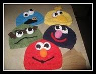 Free patterns!http://girlinair.blogspot.com/2010/07/how-to-crochet-sesame-street-hats.html