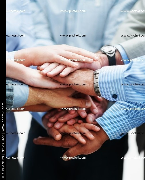http://www.photaki.com/picture-close-up-of-business-people-with-hands-clasped_231027.htm