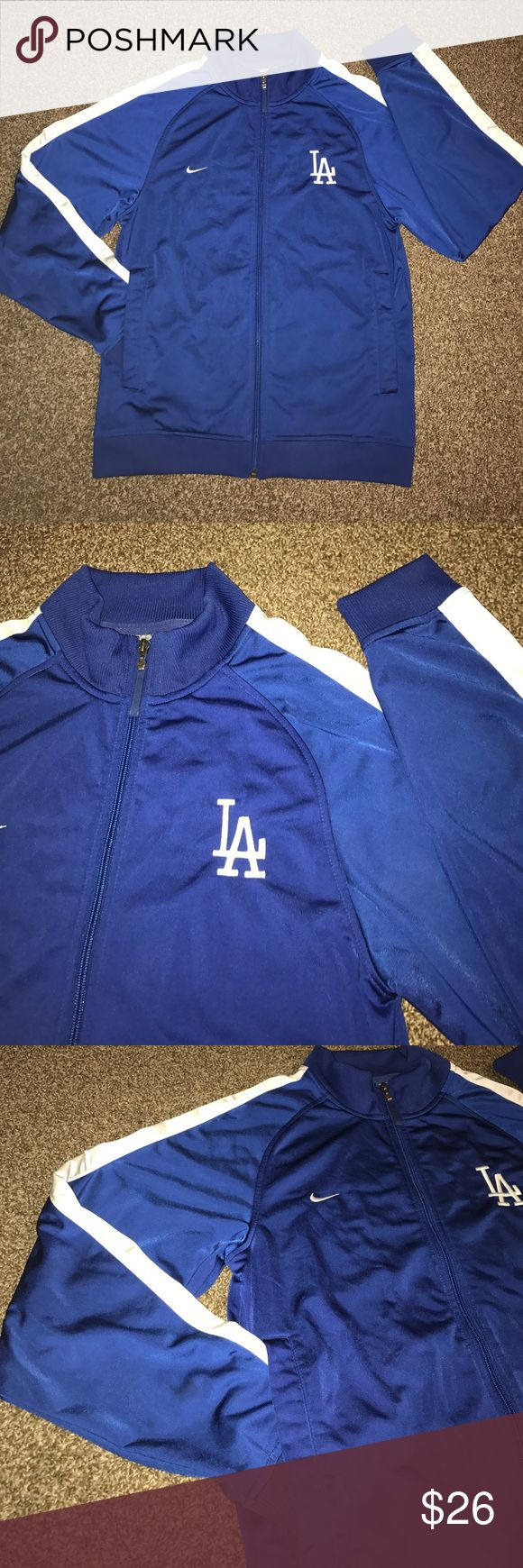 💙⚾️ NIKE LA Dodgers jacket ⚾️💙 Comfortable and classic look to this Nike genuine LA Dodgers jacket. It's in excellent condition and has been worn to many winning games! 100% polyester. It's a small size in men's, but I've worn it and I typically wear a large in tops. Cheer on your boys in blue in style! 💙 Nike Jackets & Coats