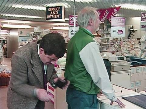Quick Clip-----Mr Bean - Credit card mix up---Mr Bean is excited to have a credit card. When he goes to pay in a department store another man gets mixed up and takes his card. Bean somehow manages to end up in a toilet cubical with the man. From The Return of Mr Bean