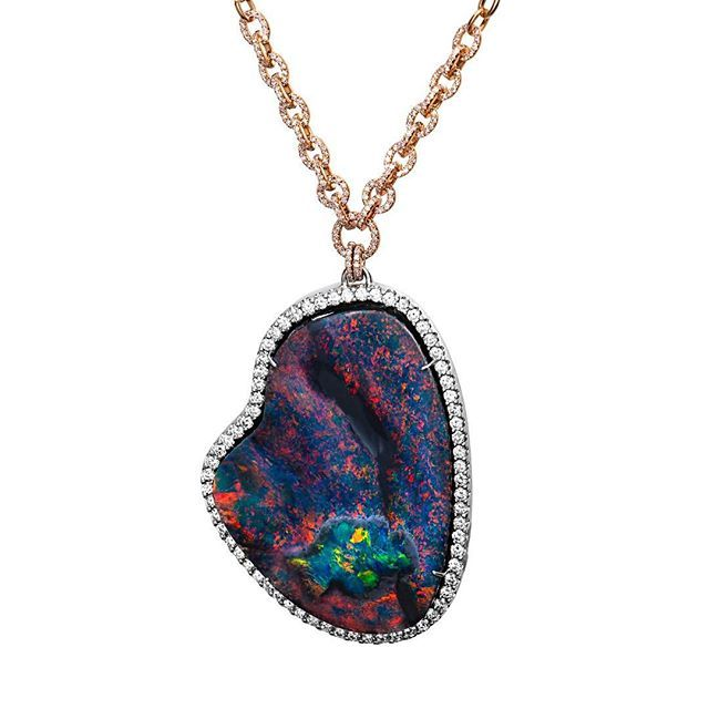 Today, we are showcasing this amazing one-of-a-kind 18K white gold pendant featuring a 98.70 ct. black Opal accented with Diamonds on a 18K rose gold chain from AGTA Member, Lightning Ridge Collection by John Ford Jewelers. #AGTA #AGTADailyGem #AGTAMember