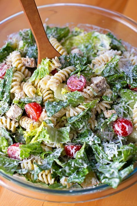 This Chicken Caesar Pasta Salad makes a great meal on it's own or even as a side dish with romaine, pasta, chicken, ripe cherry tomatoes and lots of cheese!