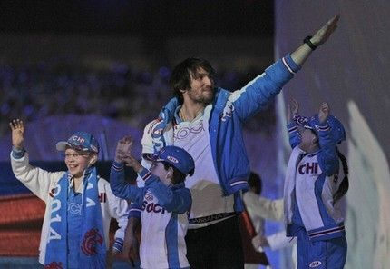 Hockey player Alexander Ovechkin waves on stage with children wearing Sochi jerseys during the closing ceremony for the Vancouver 2010 Olympics in Vancouver, British Columbia. (AP Photo/Jae C. Hong)