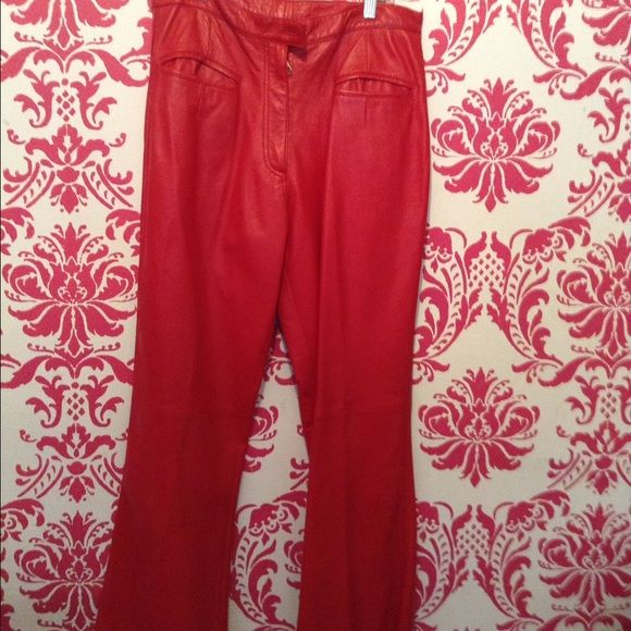 Red leather pants Great candy apple red with a bit of a flare at the bottom. Size 14 but fits small - more like 12 Pants