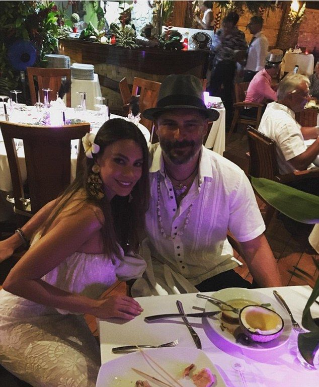 Romantic dinner: The Modern Family actress and her man leaned in together as they smiled f...
