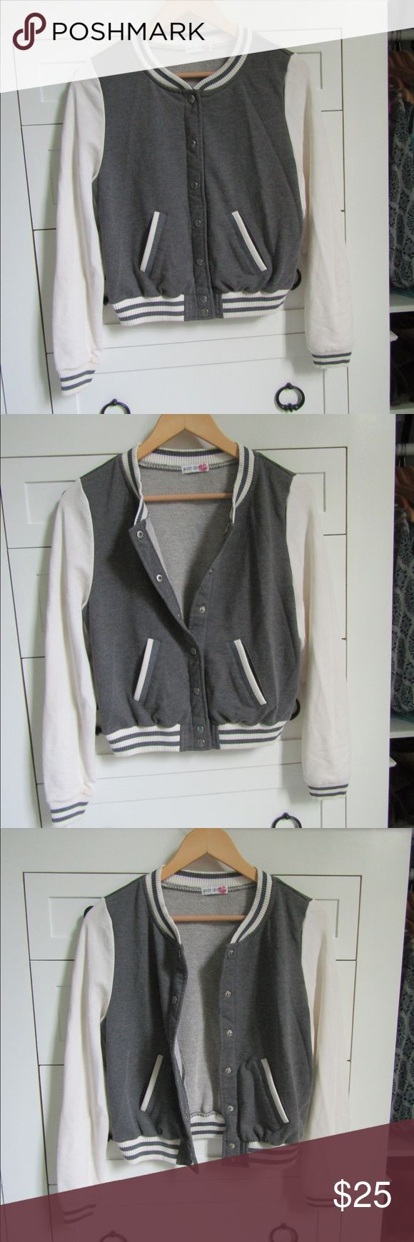 Grey and White Sporty Bomber Jacket Bomber jacket that goes with almost anything sporty. A quick add to an outfit. Buttons in the front and is plain and simple. Has 2 pockets as well Body Central Jackets & Coats Utility Jackets