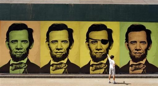 <p>A young passer-by points to a mural composed of a series of portraits that are a combination of the faces of then Democratic presidential candidate U.S. Senator Barack Obama and former U.S. President Abraham Lincoln in Boston, Massachusetts July 11, 2008. Gallery XIV commissioned the mural by artist Ron English. REUTERS/Brian Snyder</p>
