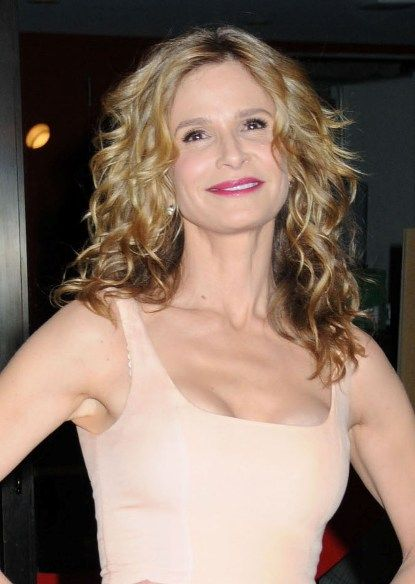 Kyra Sedgwick's blonde, curly hairstyle