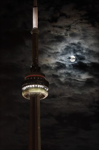 The CN Tower under a spooky full moon