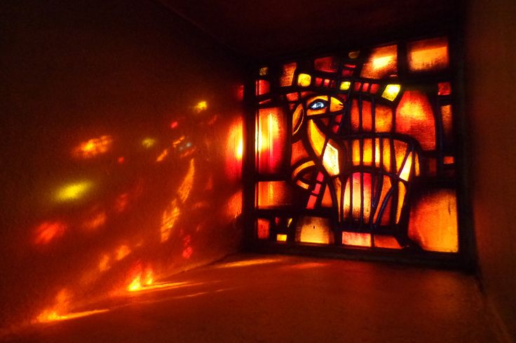 One of the stained-glass windows in the church at Taize