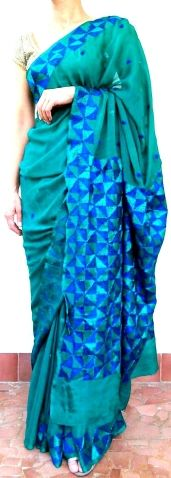 This gorgeous chinon chiffon phulkari saree is hand-embroidered in the phulkari/bagh work style. The pallu has heavy, intricate embroidery, with a border running throughout the sari and small motifs at intervals - See more at: http://giftpiper.com/Handembroidered-Chinon-Chiffon-Phulkari-Saree-GreenBlue--id-870219.html #phulkari #saree #sareeonline #sarees