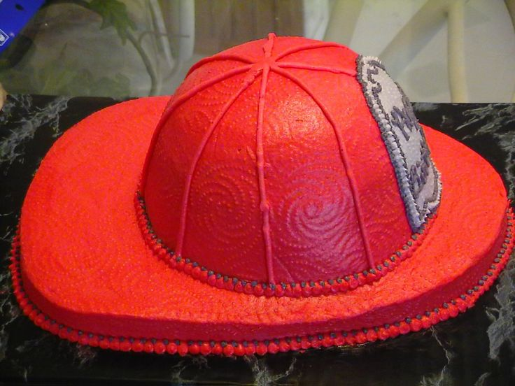 Fireman Hat - This is a white cake made to look like my son's fireman hat.  It has buttercream icing.  I had fun making it.