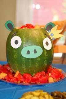 Could use a melon baller to clean out the watermelon and put the balls of watermelon on a platter around the pig...