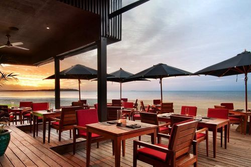 Fiji Beach Resort and Spa by Hilton - Space is a luxury and our suites have plenty of it . The flexible design makes a perfect layout for couples, friends, families and groups . The unique style one and two bedroom suites offer your home away from home with fully equipped kitchen, laundry with washer and dryer and balcony bbq . The resort also offers full service options including laundry, 24 hour in room dining and a selection of restaurants and dining facilities .