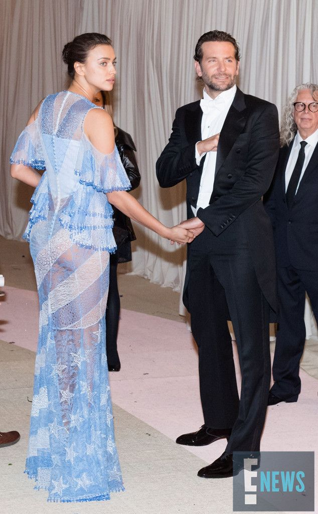 Irina Shayk & Bradley Cooper from Candid Moments From Met Gala 2016  Nothing says romance like appearing together at the Met Gala! This couple looked fabulous as they made their way inside.