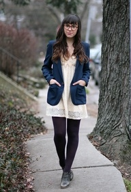 Love this modern spin on the preppy with the black tights.