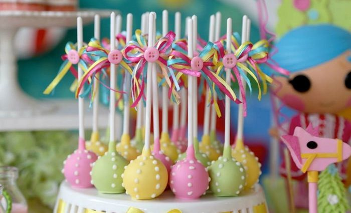 in love with the colours, ribbons and buttons of these cake pops Lalaloopsy themed birthday party via Kara's Party Ideas KarasPartyIdeas.com #lalaloopsy #karaspartyideas Invitation, decor, supplies, favors...