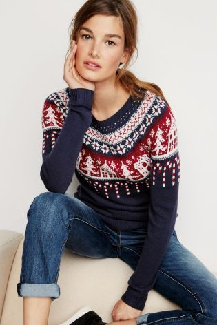 Festive trees, snowflakes and Candy cane adorn this jumper – what's not to like?