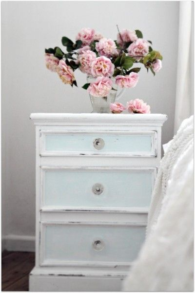Love this vintage bedside table. It's a little too distressed for me, but I love the look of it and the soft hint of colour on the drawer fronts.
