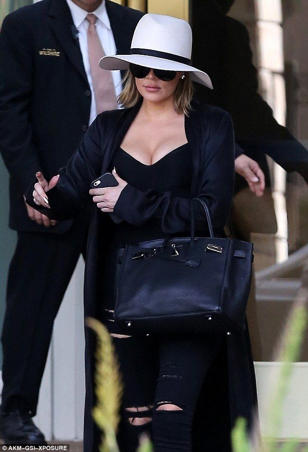 Eye-popping: Khloe Kardashian showed off her cleavage in a low-cut top while heading to lunch in Beverly Hills on Thursday