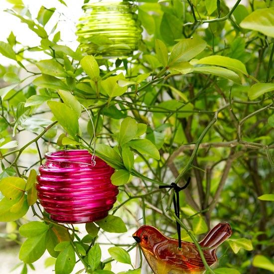 Colourful garden tealight holders