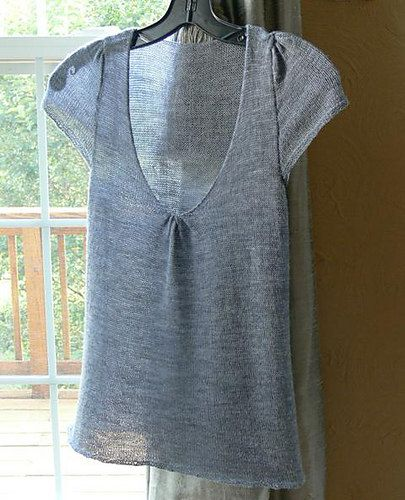 Pale grey knit top.