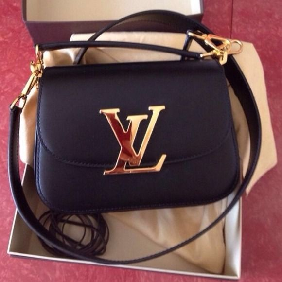 Authentic Louis Vuitton Vivienne In excellent condition, used only a few times, a little scratch in the LV metal letter. Price is firm. I don't trade. Louis Vuitton Bags