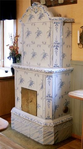 Antique Swedish tile stove installed in the dining room of a hotel.