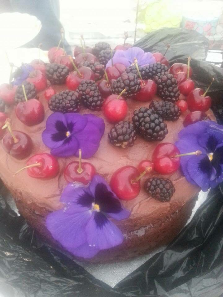 Yummy our giant chocolate berry cake