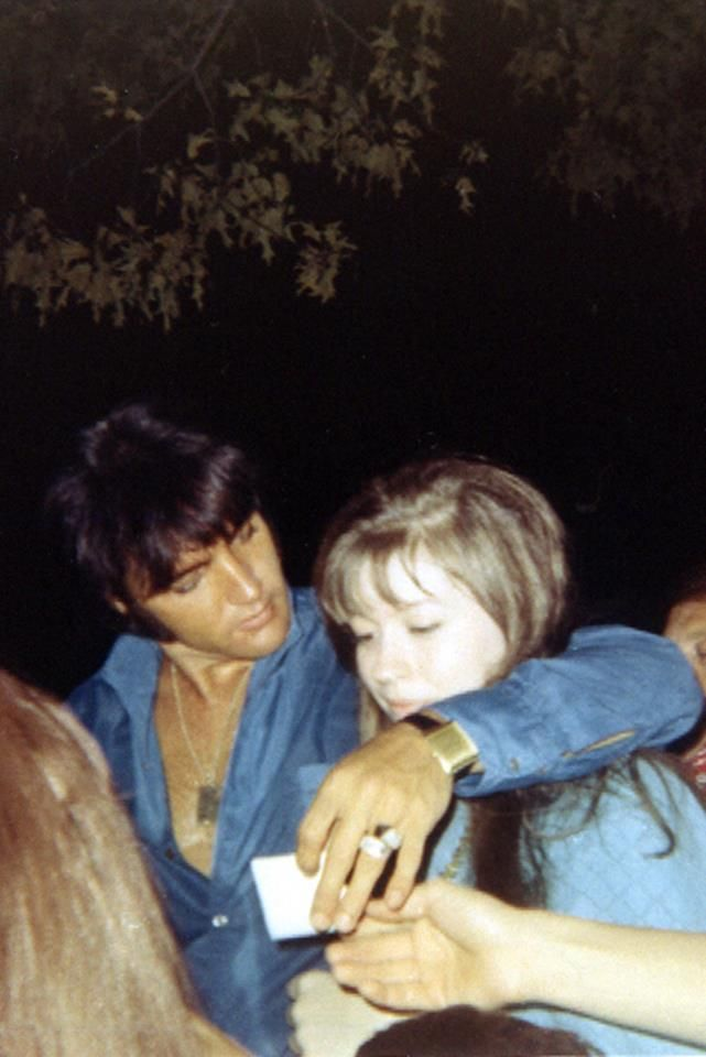 """Elvis with Donna Lewis at Graceland, July 3, 1969. Fortunately, her parents were Elvis fans and they moved to Memphis. Donna was a fan who was fortunate enough to be friends with Elvis. She wrote three books (""""Hurry Home Elvis"""") made from volumes of her diaries during that time. Volume I deals with 1962-1966, Volume II with 1967-1968 and Volume III is about 1969-1977. Donna's diaries offer a great day-by-day account of Elvis' semi-public comings and goings, during the time he resided in…"""