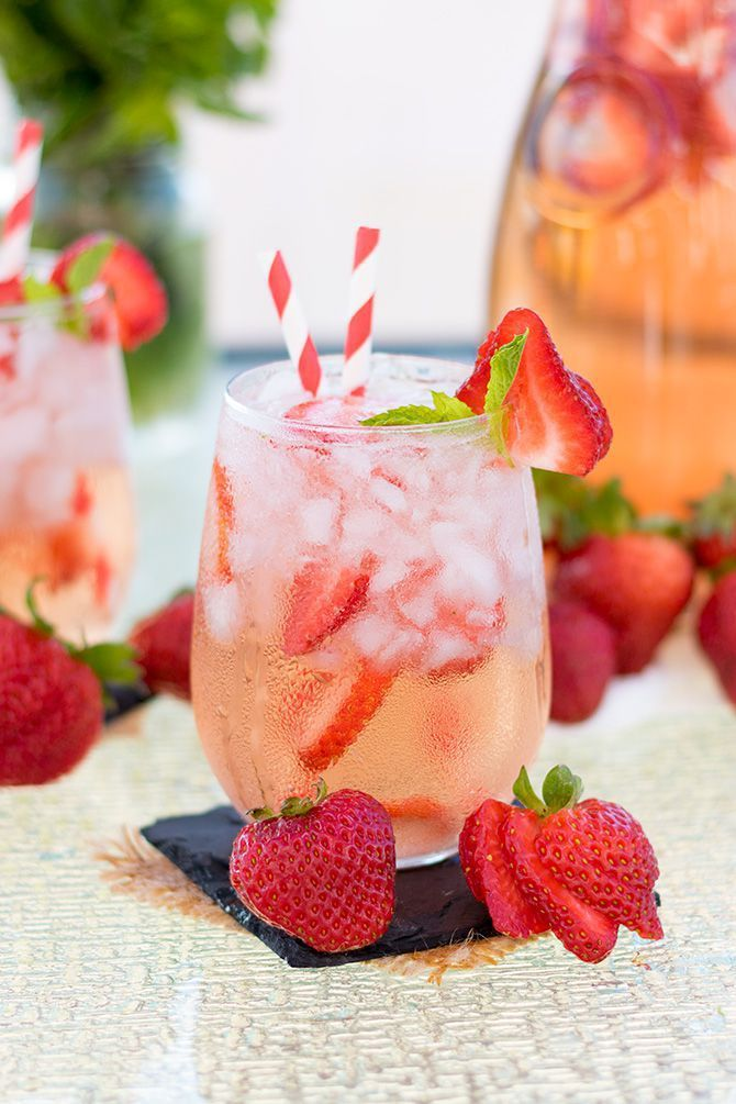 Quick and simple sangria made with fresh strawberries, rosé wine, and kicked up with some vodka!  #cowgirl #cowgirldrinks   http://www.islandcowgirl.com/
