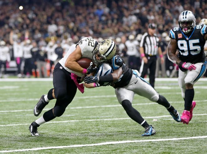 Panthers vs. Saints:      October 16, 2016  -  41-38, Saints  -    Carolina Panthers at New Orleans Saints  Oct 16, 2016; New Orleans, LA, USA; New Orleans Saints tight end Coby Fleener (82) scores on a two-yard run while defended by Carolina Panthers free safety Tre Boston (33) in the first quarter of the game at the Mercedes-Benz Superdome. Mandatory Credit: Chuck Cook-USA TODAY Sports